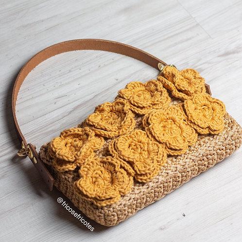 Bolsa baguete flores mostrada