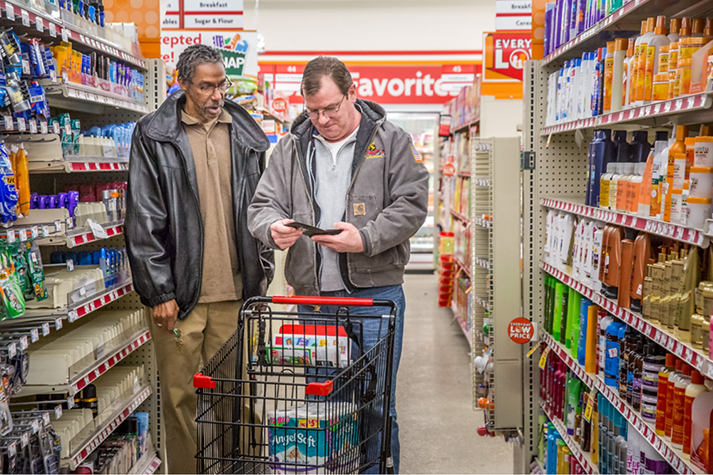 Jerome Arnold, left, a case manager at the Criminal Justice Ministry, took client Chris Meyer shopping. After receiving assistance from the ministry, Arnold described his work as a case manager there as a dream come true, and since January has been helping veterans reintegrate into society. Photo Credits: Lisa Johnston | lisajohnston@archstl.org | twitter: @aeternusphoto