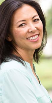 hispanic-woman-smiling-outdoors-613x345.