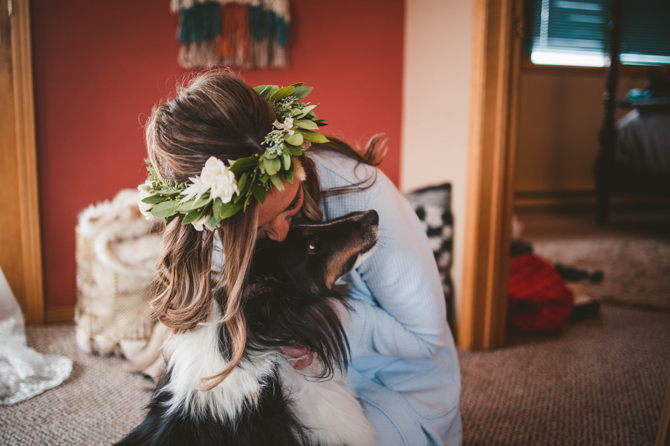 A bride and her dog at her Montana Wedding