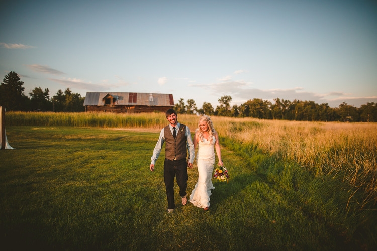 Anna and Tom Beers take a walk around their wedding venue at the 1915 Barn in Bozeman, MT