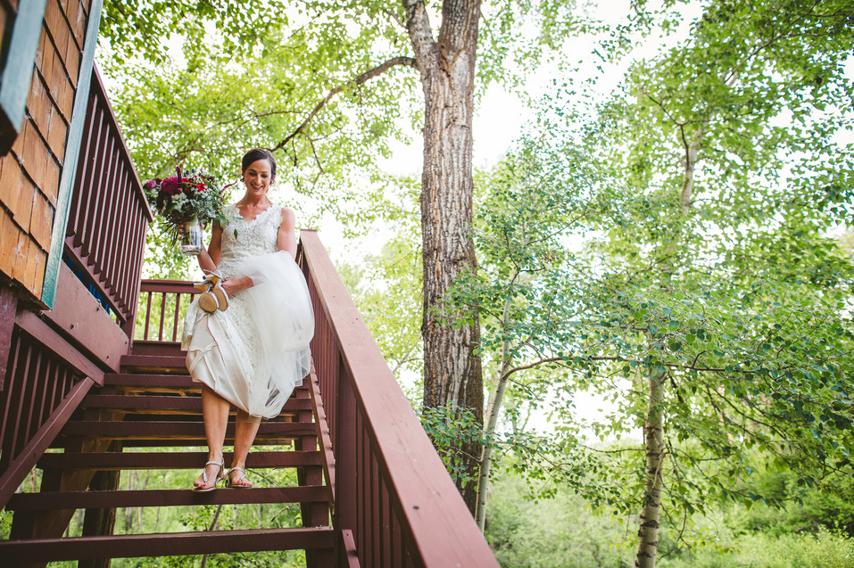 Beth walks toward her wedding at the Gallatin River Hideaway in Bozeman, Montana