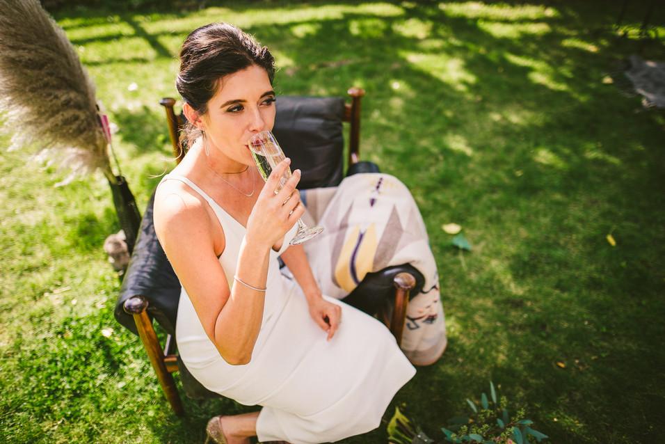 Eleana sips champagne at her wedding in Helena, Montana