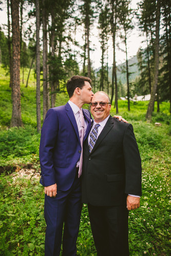 Brandon shares a funny moment with his father before his wedding at the Woodlands in Bozeman