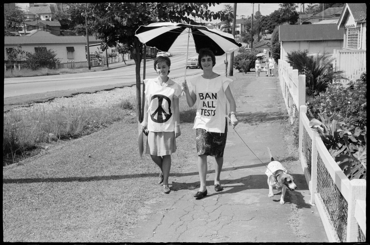 Two young women with dog during Aldermaston Peace March, Brisbane, 1964