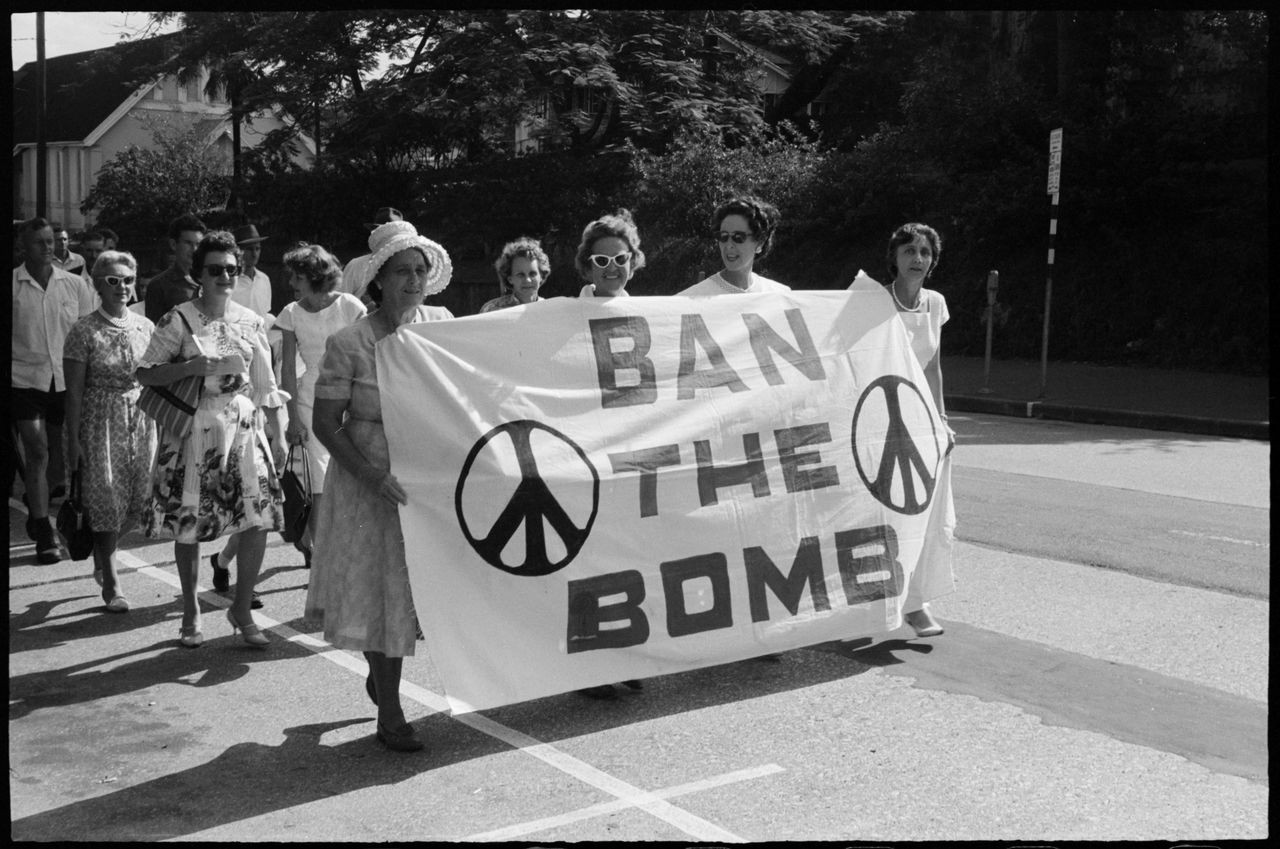 Women with Ban the Bomb banner during Aldermaston Peace March, Brisbane, 1964