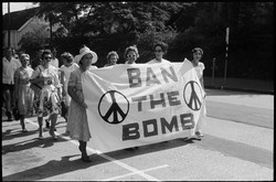Women with Ban the Bomb banner during Al