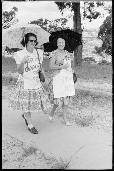 Women with umbrellas during Aldermaston Peace March, Brisbane, 1964