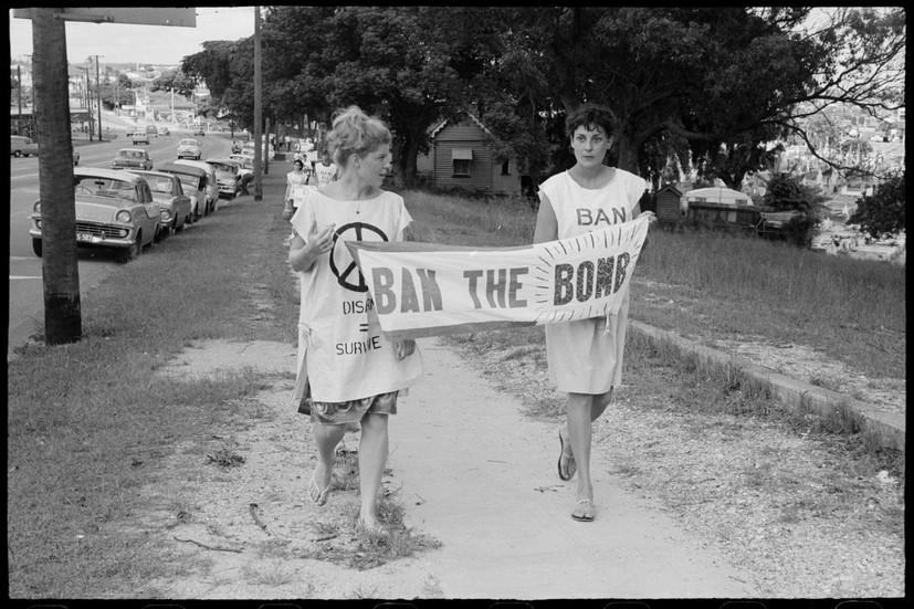 Women with banner during Aldermaston Peace March, Brisbane, 1964