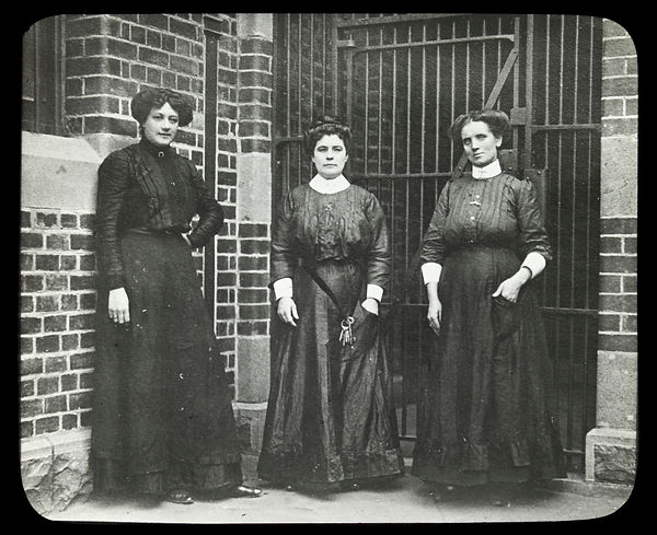Female wardens with keys, standing in a