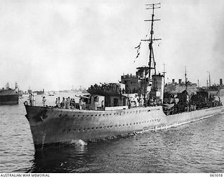 HMAS Nizam loaded with troops being with