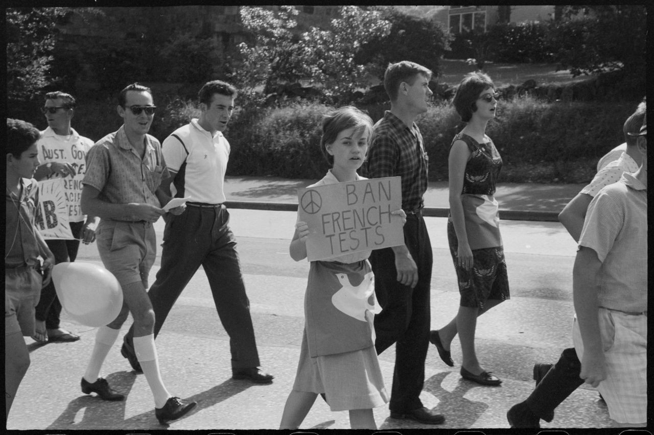 Young woman with placard during Aldermaston Peace March, Brisbane, 1964
