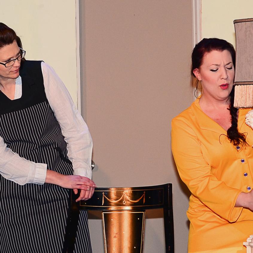 Berthe regards Gretchen's expression