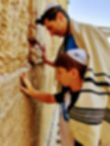 Western Wall family prayer Jerusalem father and son Jew Jewish Israel tour company israel culinary tour of israel private tour guide of israel personalized israel experience bar or bat mitzvah trip to israel
