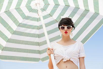 Beachwear Model under umbrella