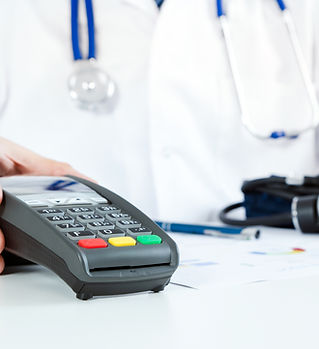 POS terminal in doctor's office. Pay for