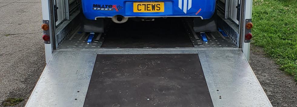 car in trailer with Chevron logo.jpg