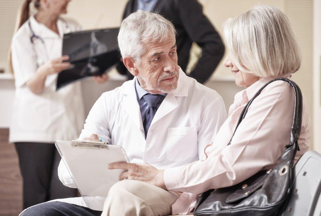 Elderly doctor with elderly patient
