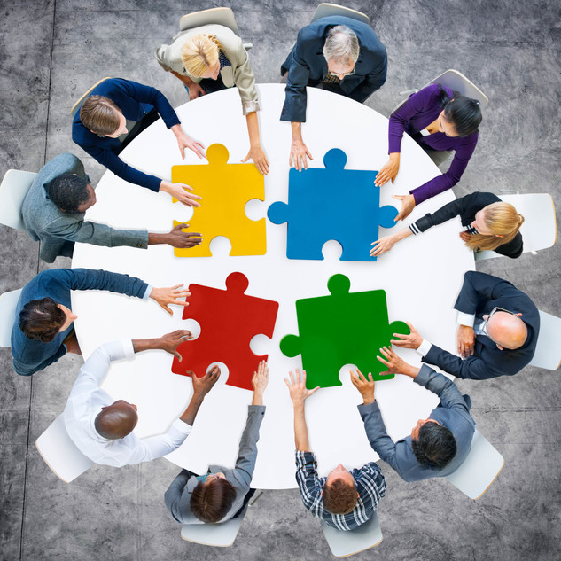 People putting puzzle together