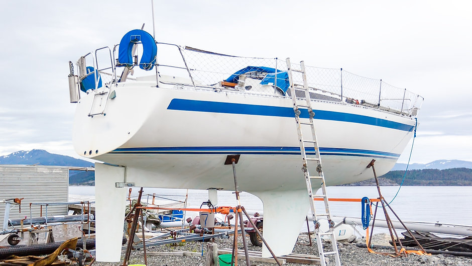 A%2520white%2520boat%2520being%2520repaired%2520and%2520restored%2520in%2520the%2520port_edited_edit