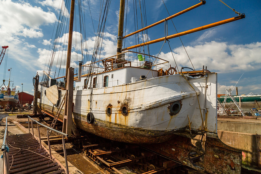 Large old sailing boat undergoing seriou