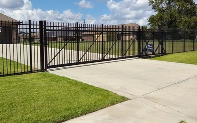 We install Gates of all sizes. This is a 30' wide 6 foot tall Aluminum cantilever gate._edited.jpg
