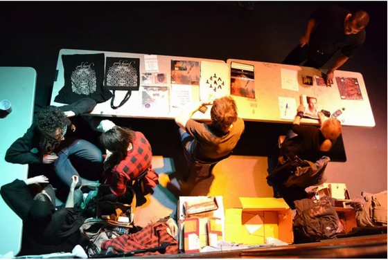 7 Out-of-the-Box Ideas to Attract People to Your Band Merch Table