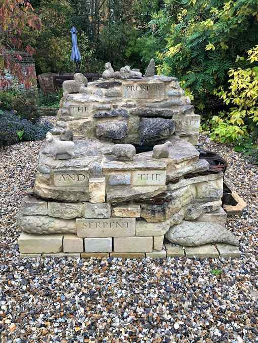 Limestone sculpture based on an old Oxfordshire folktale about serpents and sheep (naturally!)