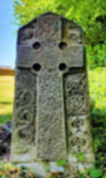 A small stone in a churchyard in the Land of the Twelve Churches in Shill Valley and Broadshire