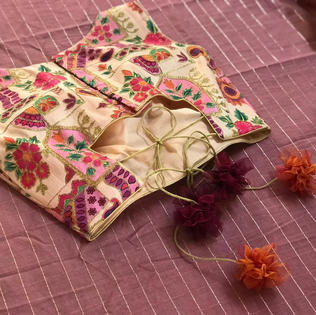 Aari work multicolored pompom danglers.j