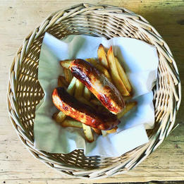 sausage and chips in a basket
