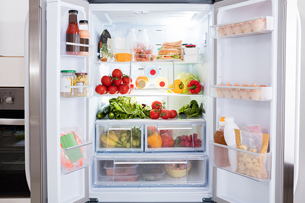 Fridge stocked with vegetables and fruit