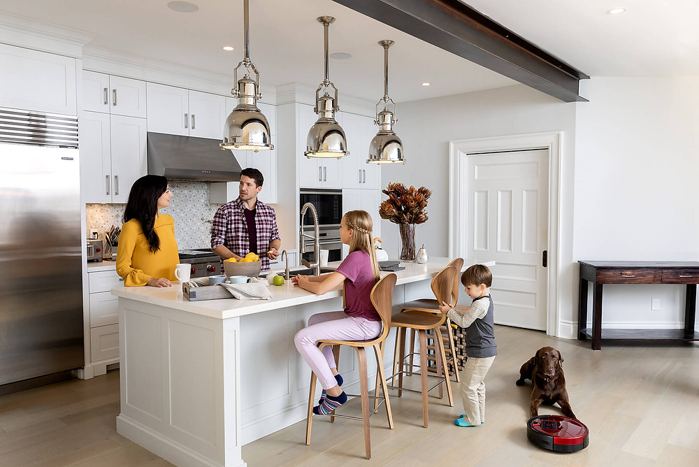 Family and dog in kitchen with Bob PetHair cleaning