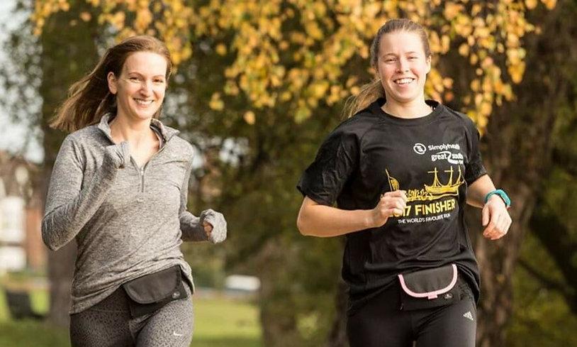 2 women running Pink + Black.JPG