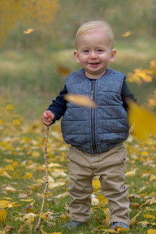 Boy throwing leaves