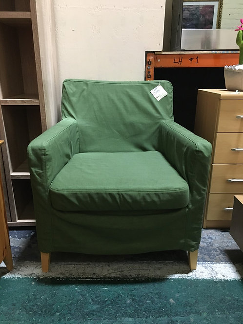 Armchair with green slip cover