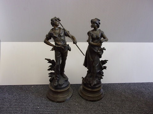 Male and Female Statues