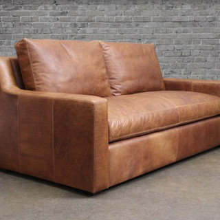 Belgian slope arm leather.jpg