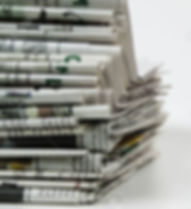 10054021-pile-of-newspaper.jpg
