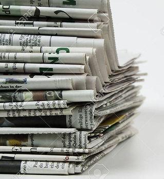 10054021-pile-of-newspaper.jpg