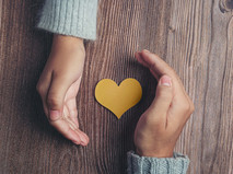 paper-heart-couple-s-hands-wooden-table_SQUARE.jpg