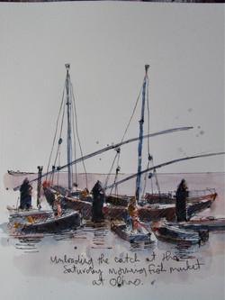 Fishing boat unloading Algarve