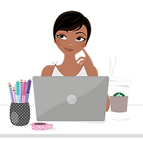black female with short hair sitting at desk with laptop