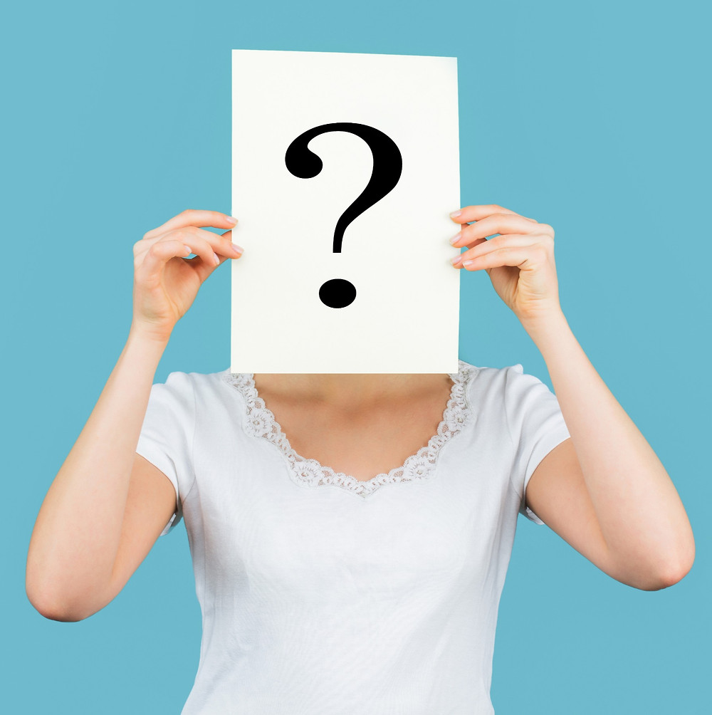 Graphic- female holding up a question mark sign