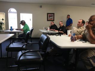 District Attorney teaches class regarding search warrants