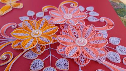 Rosa og oransje blomster.jpg