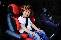 baby boy with curly hair sitting in red