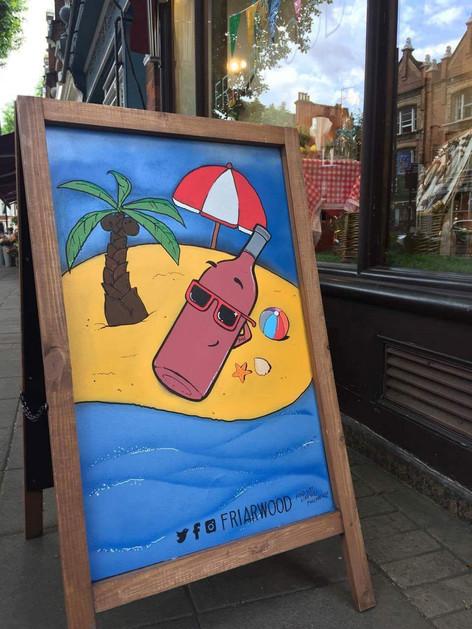 chalk board art wine on beach