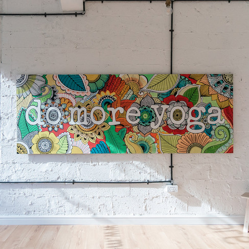 Hand painted 'Do More Yoga' sign