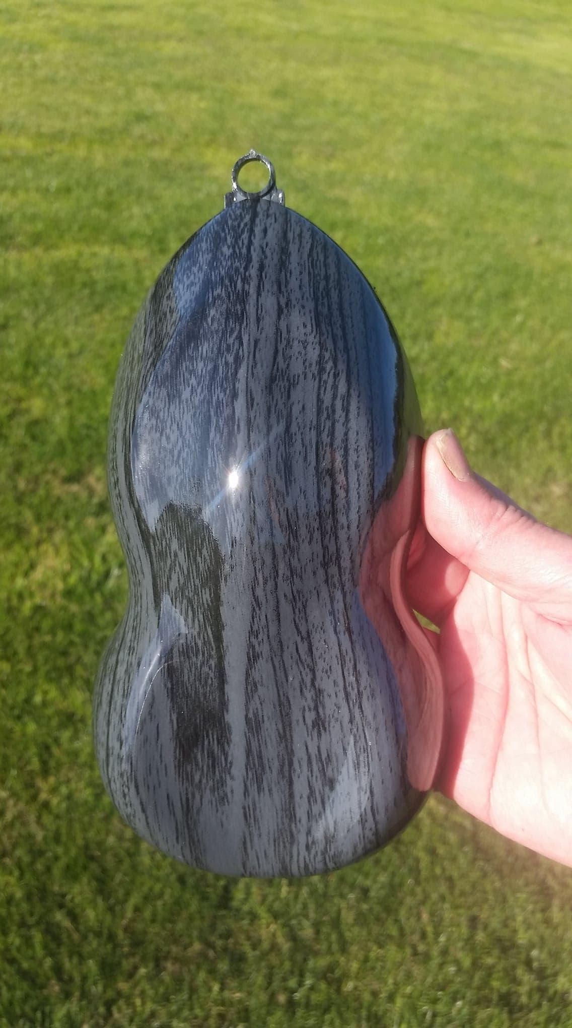 Grey-Black woodgrain with a dark Grey ba